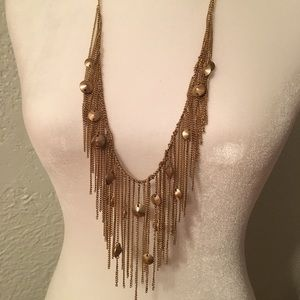 Dramatic gold tone castanet necklace